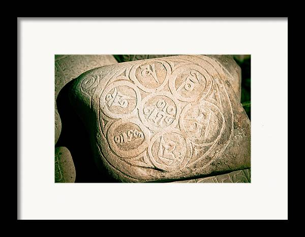 Wisdom Framed Print featuring the photograph writing on the Tibetan language and Sanskrit at stone by Raimond Klavins