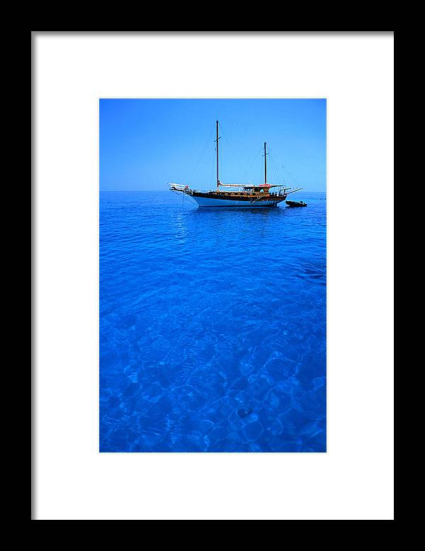Freight Transportation Framed Print featuring the photograph Yacht Anchored In The Spectacular by Dallas Stribley
