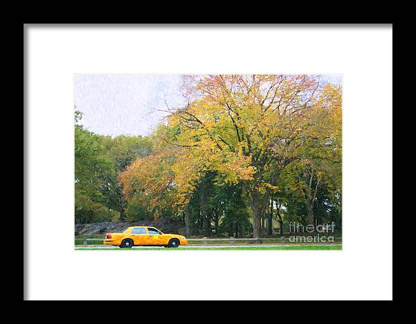 Nyc Taxi Framed Print featuring the digital art Yellow Nyc Taxi Driving Through Central Park Usa by Liz Leyden