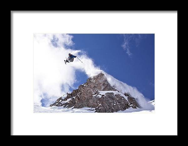 Action Framed Print featuring the photograph Young Man Catches Huge Air While by Henry Georgi