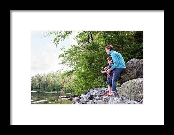6-7 Years Framed Print featuring the photograph Young Mother Helping Son Fish At Kezar by Monica Donovan