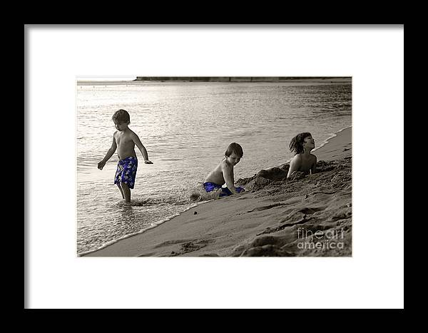 Boys Framed Print featuring the photograph Youth At The Beach by Madeline Ellis