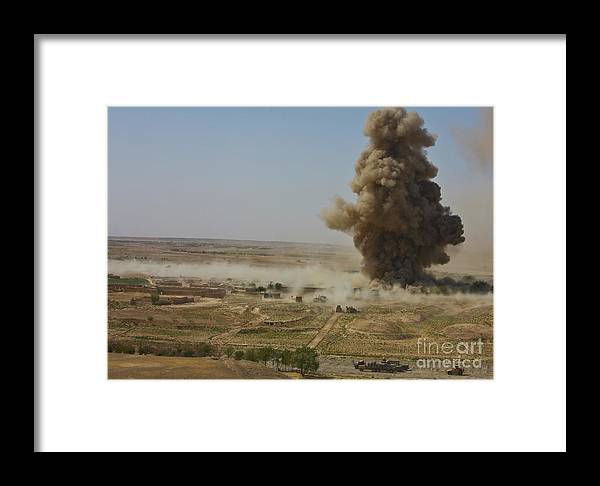 Improvised Explosive Device Framed Print featuring the photograph A Cloud Of Dust And Debris Rises by Stocktrek Images