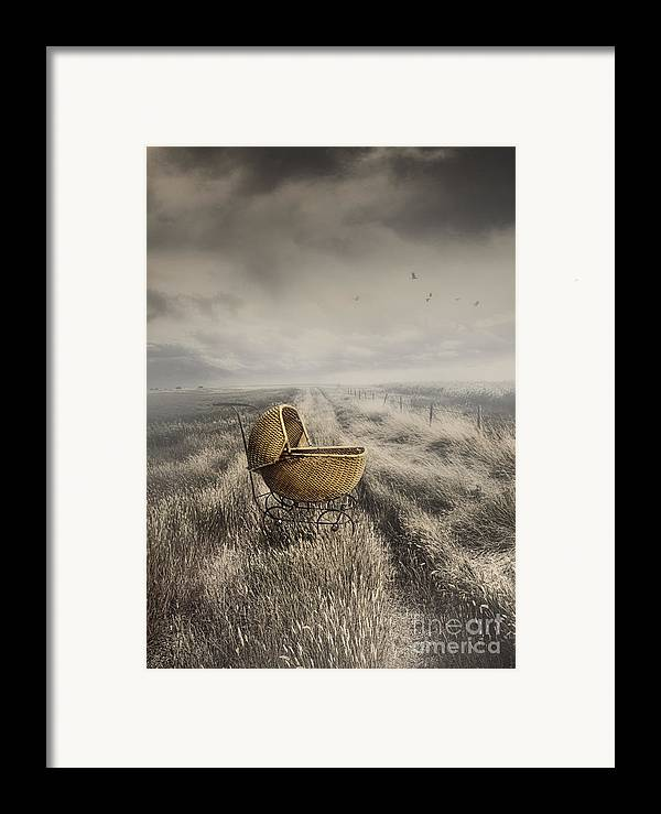 Abandoned Framed Print featuring the photograph Abandoned Antique Baby Carriage In Field by Sandra Cunningham