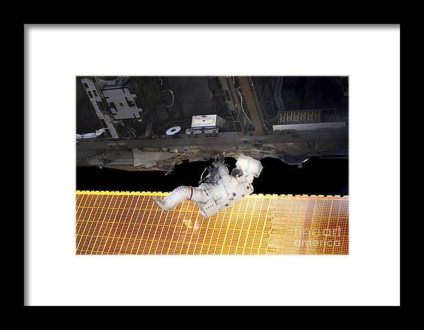 Adults Only Framed Print featuring the photograph Astronaut Participates In A Spacewalk by Stocktrek Images