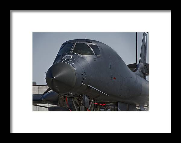 B-1 Bomber Framed Print featuring the photograph B-1 Bomber by Eric Miller