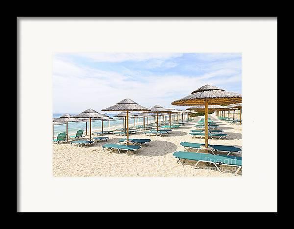 Beach Framed Print featuring the photograph Beach Umbrellas On Sandy Seashore by Elena Elisseeva