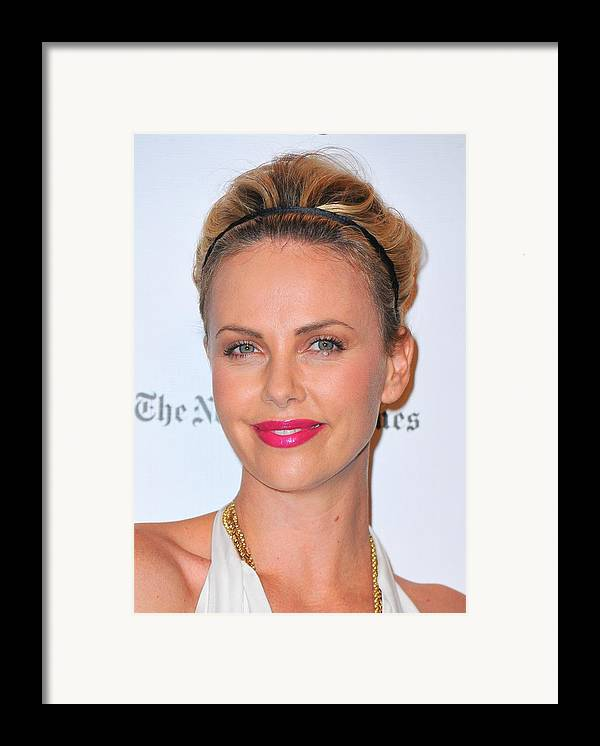Charlize Theron Framed Print featuring the photograph Charlize Theron Wearing A Jennifer Behr by Everett