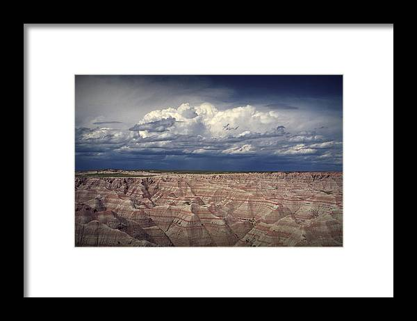 Art Framed Print featuring the photograph Cloud Formation In Badlands National Park by Randall Nyhof