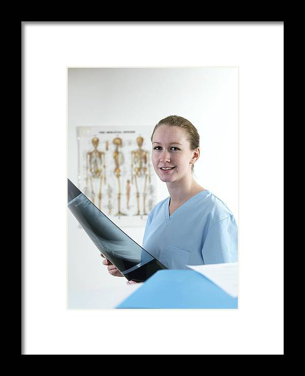 Adult Framed Print featuring the photograph Doctor Studying An X-ray by Tek Image