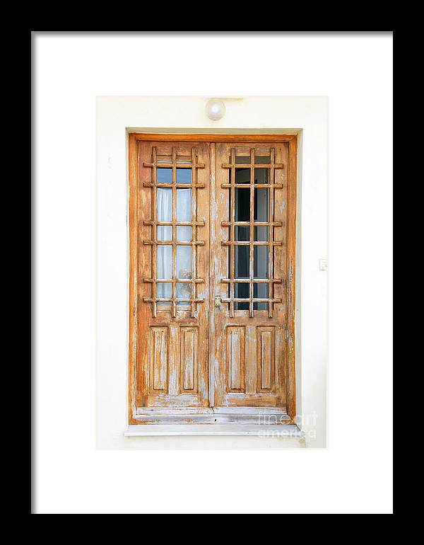 Doors In Greece Framed Print featuring the photograph Doors In Greece by Maria Varnalis