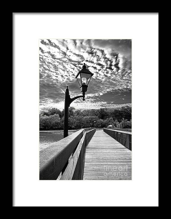 Black And White Photography Framed Print featuring the photograph Guiding Light by Sue Stefanowicz