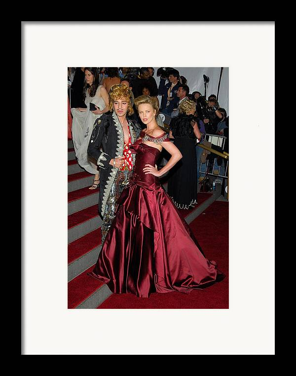 Anglomania Tradition And Transgression In British Fashion Opening Gala Framed Print featuring the photograph John Galliano, Charlize Theron Wearing by Everett