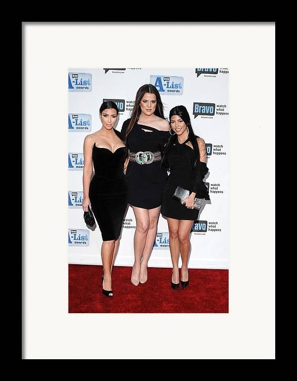Kim Kardashian Framed Print featuring the photograph Kim Kardashian, Khloe Kardashian by Everett