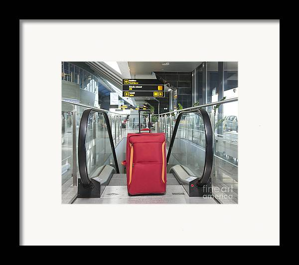 Abandoned Framed Print featuring the photograph Luggage At The Top Of An Escalator by Jaak Nilson
