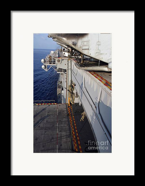 Aircraft Framed Print featuring the photograph Marines And Sailors Fast-rope by Stocktrek Images