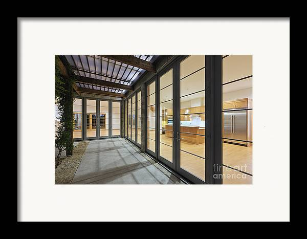 Architecture Framed Print featuring the photograph Modern Home Kitchen Through Glass Doors by Jeremy Woodhouse