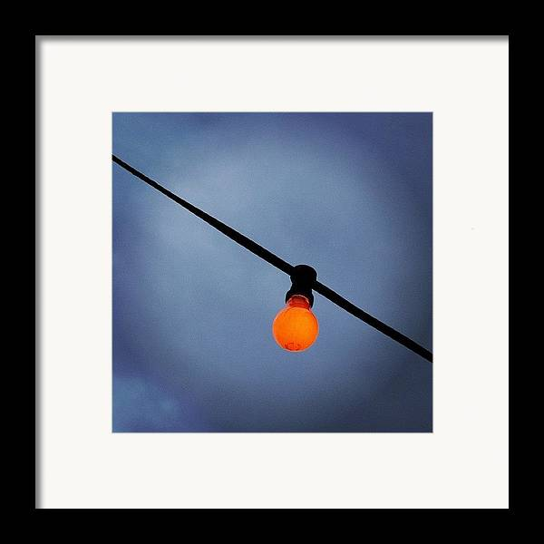 Orange Framed Print featuring the photograph Orange Light Bulb by Matthias Hauser