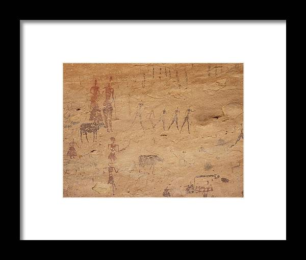 Acacus Framed Print featuring the photograph Pictograph Of Walking Figures by David Parker