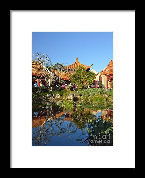 Epcot Framed Print featuring the photograph Reflecting Pond by Carol Bradley