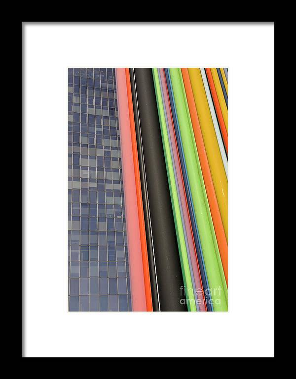 Domination Framed Print featuring the photograph Skyscraper And Multi Coloured Stripes by Sami Sarkis