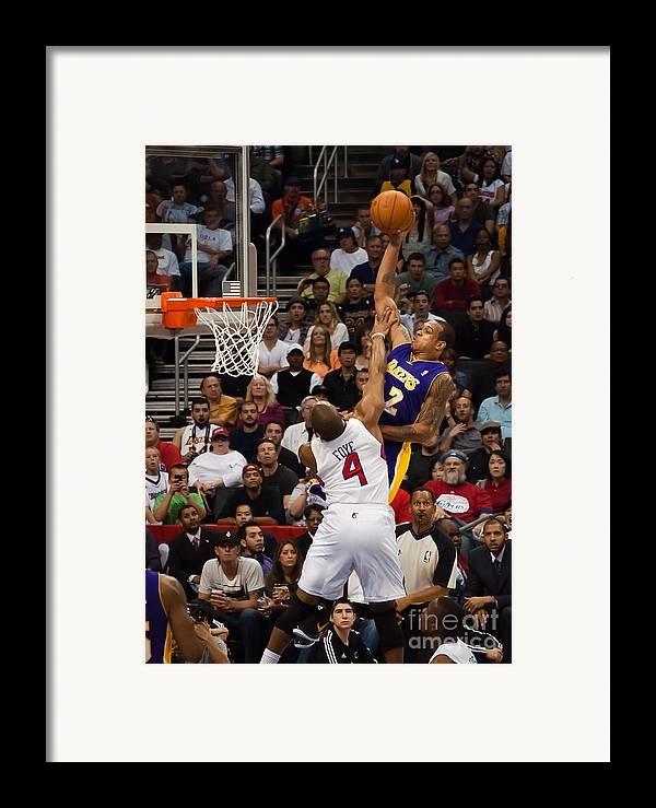 Slam Dunk Framed Print featuring the photograph Slam Dunk by Eddie Yerkish