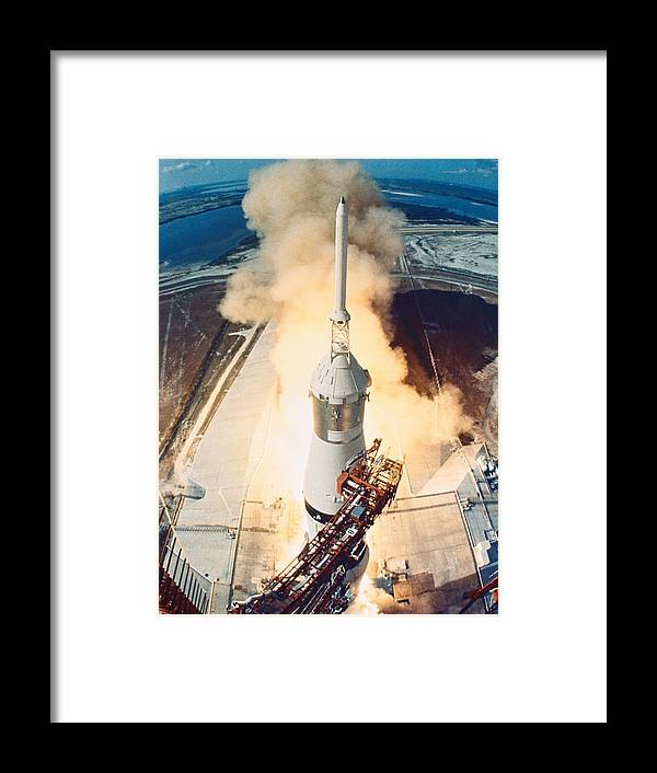 Vertical Framed Print featuring the photograph The Launch Of A Space Rocket by Stockbyte