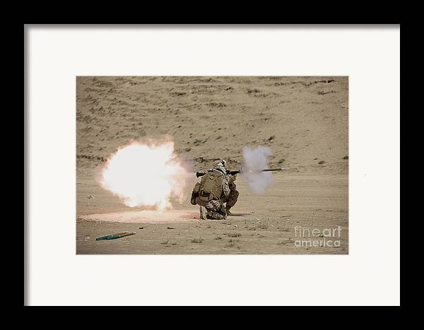 Afghanistan Framed Print featuring the photograph U.s. Marine Fires A Rpg-7 Grenade by Terry Moore
