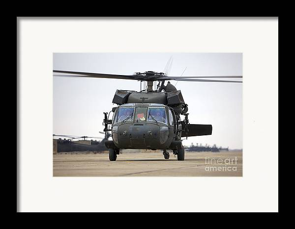 Aviation Framed Print featuring the photograph A Uh-60 Black Hawk Taxis by Terry Moore