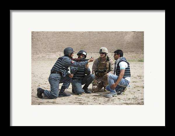 Afghanistan Framed Print featuring the photograph An Afghan Police Student Loads A Rpg-7 by Terry Moore