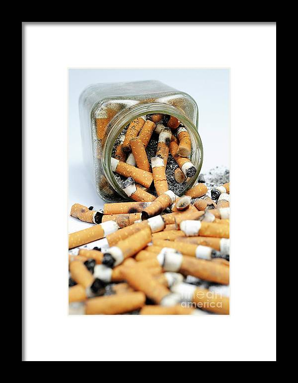Ugliness Framed Print featuring the photograph Jar Overflowing With Cigarette Butts by Sami Sarkis