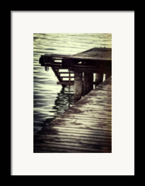 Bridge Framed Print featuring the photograph Old Wooden Pier With Stairs Into The Lake by Joana Kruse