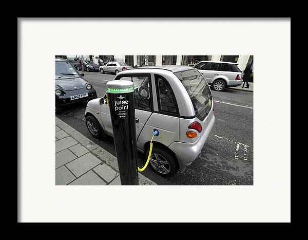 Reva Framed Print featuring the photograph Recharging An Electric Car by Martin Bond