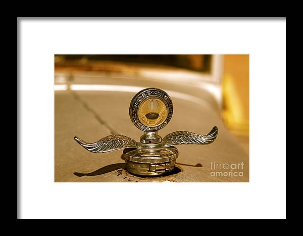 Car Framed Print featuring the photograph Rusted Antique Ford Car Brand Ornament by ELITE IMAGE photography By Chad McDermott