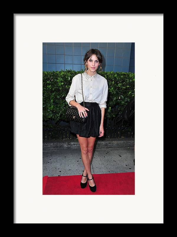 Alexa Chung Framed Print featuring the photograph Alexa Chung Wearing A 3.1 Phillip Lim by Everett