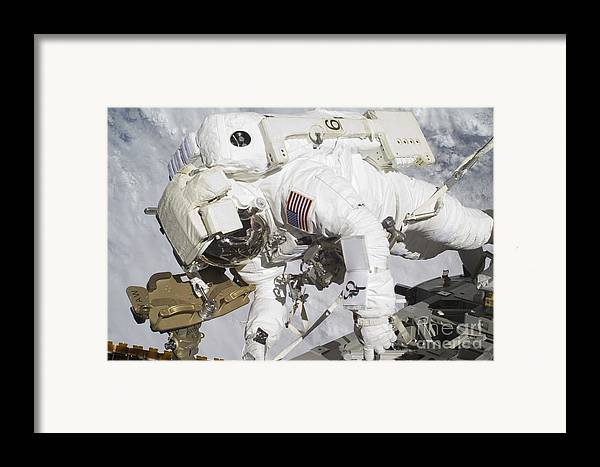 Components Framed Print featuring the photograph An Astronaut Participates In A Session by Stocktrek Images