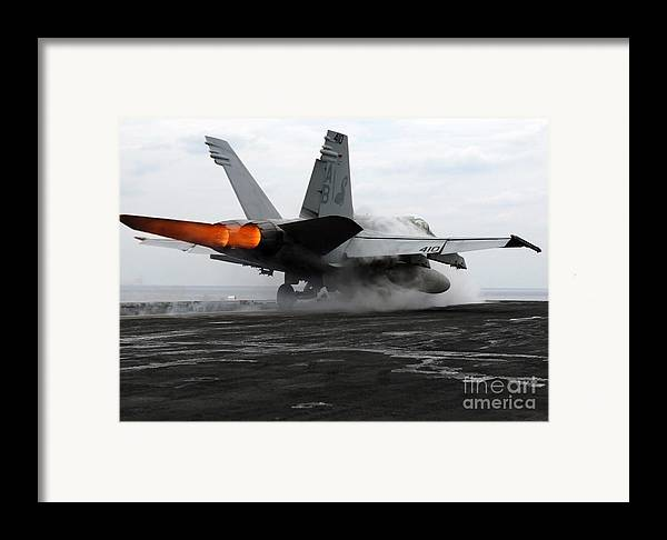 Color Image Framed Print featuring the photograph An Fa-18c Hornet Launches by Stocktrek Images