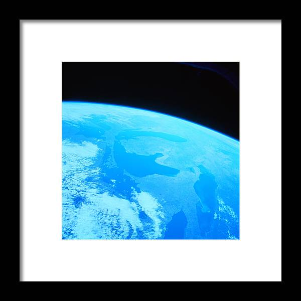 Square Framed Print featuring the photograph Earth Viewed From A Satellite by Stockbyte