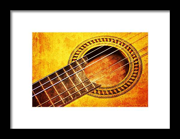 Aged Framed Print featuring the mixed media Old Guitar by Nattapon Wongwean