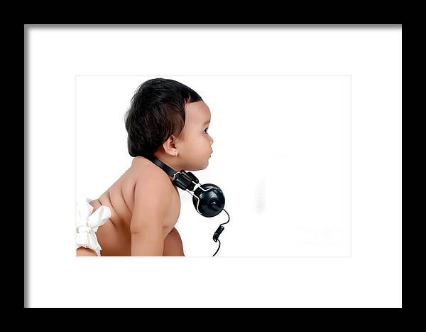 Baby Framed Print featuring the photograph A Chubby Little Girl With Headphones by Antoni Halim