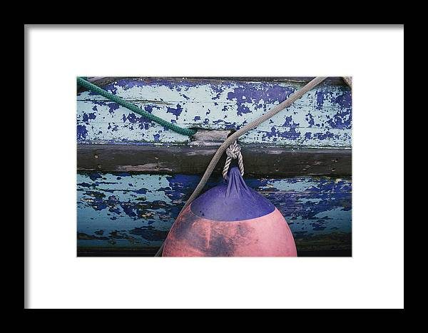 Kodiak Island Framed Print featuring the photograph A Colorful Buoy Hangs From Ropes by George F. Mobley