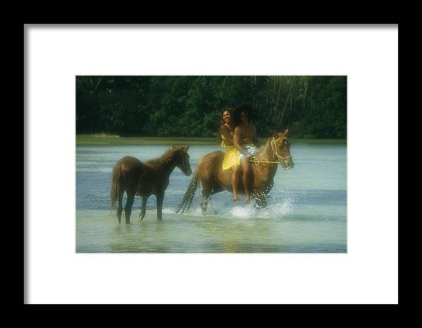 Pacific Islands Framed Print featuring the photograph A Couple Rides A Horse In A Shallow by Paul Chesley