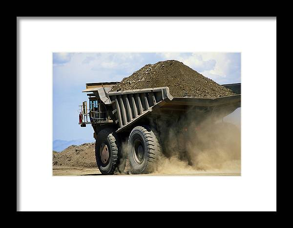 united States Framed Print featuring the photograph A Dump Truck Carrying Gravel Kicks by Raymond Gehman