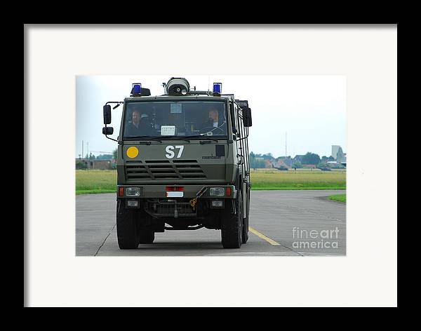 Air Component Framed Print featuring the photograph A Fire Engine Based At The Air Force by Luc De Jaeger