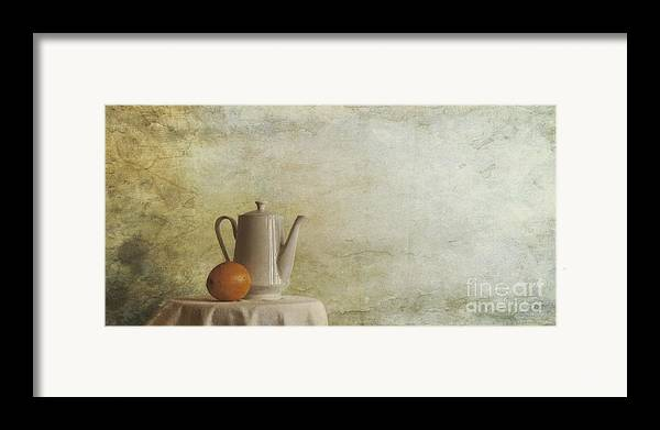 Table Framed Print featuring the photograph A Jugful Tea And A Orange by Priska Wettstein