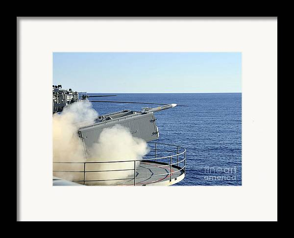 Rim-7 Framed Print featuring the photograph A Rim-7 Sea Sparrow Is Launched by Stocktrek Images