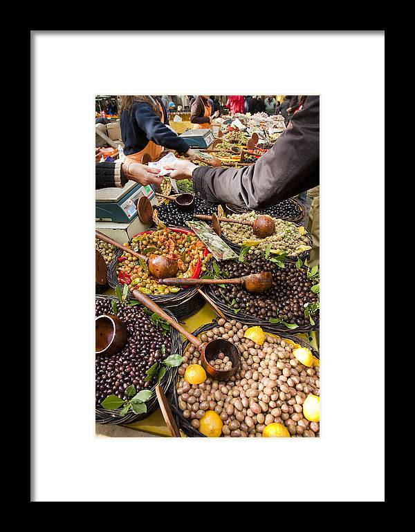 Medium Group Of People Framed Print featuring the photograph A Selection Of Olives Sit by Taylor S. Kennedy