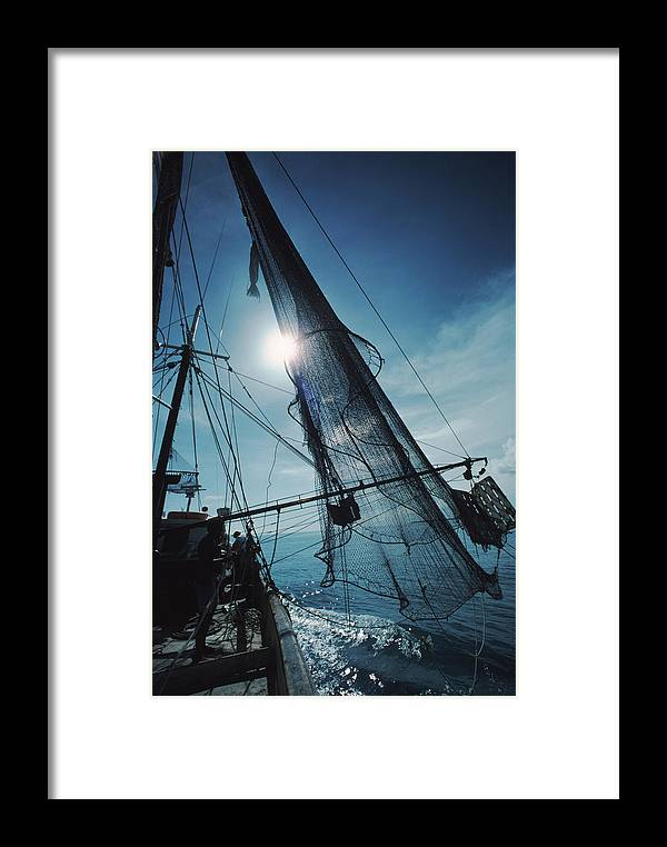 Shrimping Framed Print featuring the photograph A Shrimping Boat Off The Coast by Ira Block