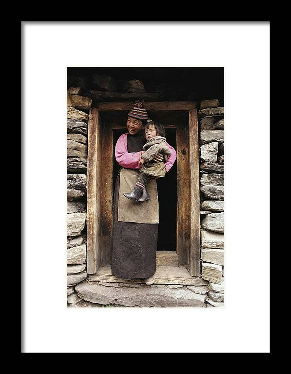 Asia Framed Print featuring the photograph A Smiling Bhutanese Woman And Child by Paul Chesley