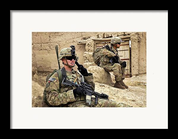 Afghanistan National Police Framed Print featuring the photograph A Soldier Calls In Description by Stocktrek Images
